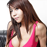 Beautiful brunette Nancy shows off her sexy thai ladyboy ass and big uncut cock
